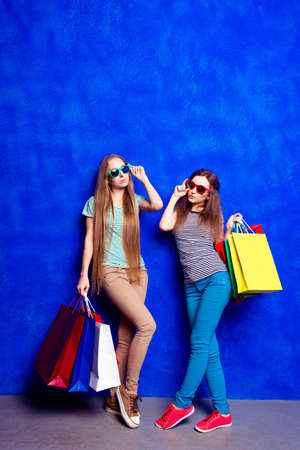 paperbags: Two pretty women with paperbags doing shopping in the mall
