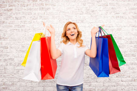 paperbags: Happy woman with paperbags doing shopping in the mall Stock Photo