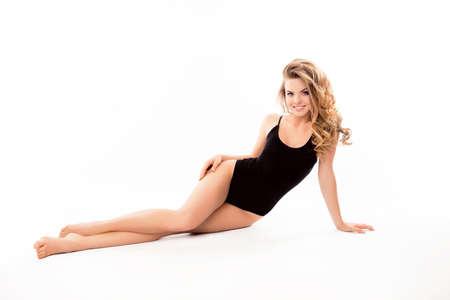 Pretty happy young girl in black swimwear sunbathing Stock Photo