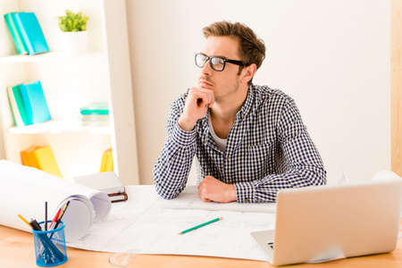 way of thinking: Tired man in glasses thinking about way to complete project