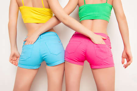 Close up photo of shapely womans buttocks in color shorts Stock Photo