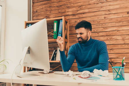 difficult to find: Angry sad man trying to find way to solve difficult task Stock Photo