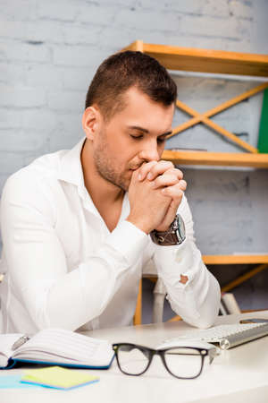 way of thinking: Portrait of overworked man thinking about way to solve his problems