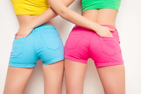 booty shorts: Photo of shapely womans back in color shorts