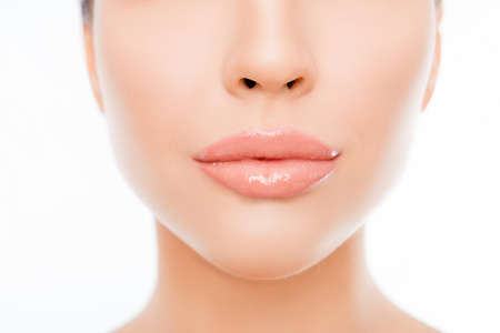 Close up photo of woman's face with perfect skin and lips Фото со стока