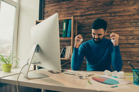 man yelling: Overworked sad man yelling while working in office