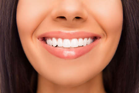 beaming: Close up photo of beaming womans smile and healthy teeth