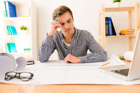 to ponder: Ponder tired architect thinking about way to draw scheme Stock Photo