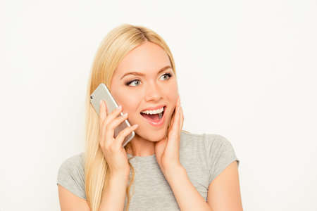 Surprised  cheerful happy woman talking on mobile phone