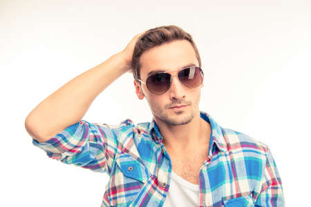 holding on head: Handsome man with  glasses holding head