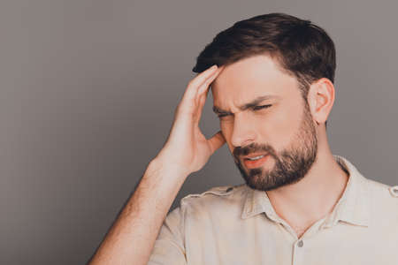 Young guy with big problems having strong headache Stock Photo