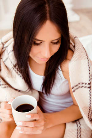 Portrait of pretty woman with cup of coffee dreaming
