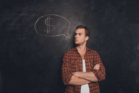 earn money: Serious businessman with crossed hands thinking how to earn money Stock Photo