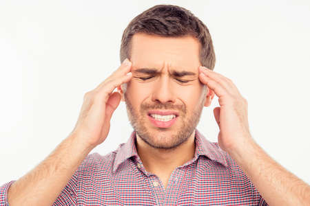 Attractive man suffering of headache Stock Photo