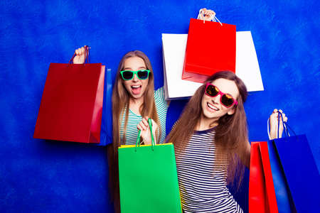 packets: Attractive happy customers with packets  of clothes after shopping
