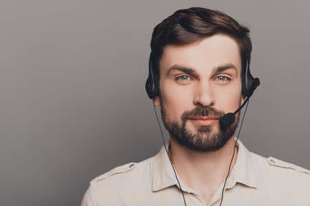 caller: Portrait of handsome smiling man in head-phones in call center