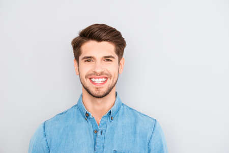 Young happy smiling man isolated on gray background Stock Photo