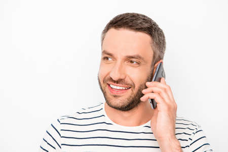 beaming: Cheerful man with beaming smile having conversation on phone Stock Photo