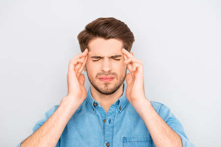 spite: Portrait of sick sad businessman having strong headache