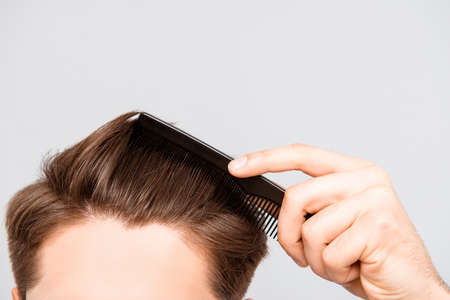 Close up photo of clean healthy mans hair without furfur