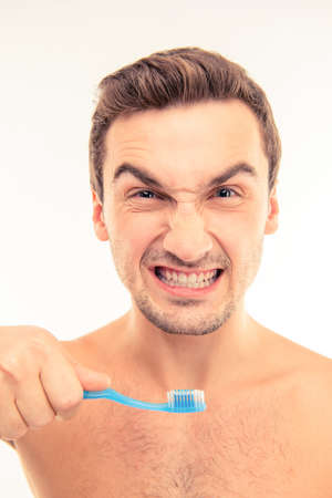 express positivity: Funny young man holding toothbrush