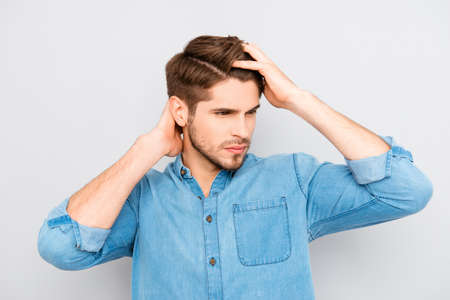 Portrait of healthy man combing his hair with fingers Stock Photo - 61229894