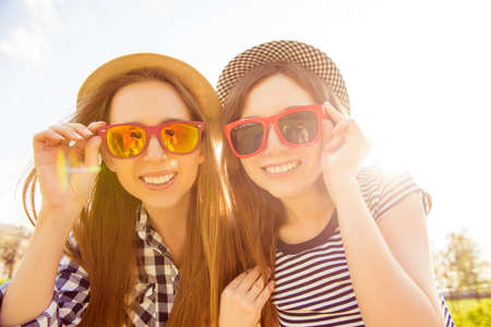 wearing spectacles: Portrait of beautiful girls with beamings smiles wearing spectacles