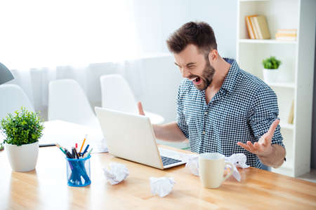 angry man in rage having bad mood screaming in office