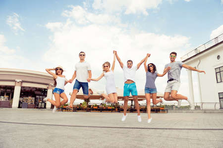 achieving: joyful success six friends having fun, achieving goal  and  jumping