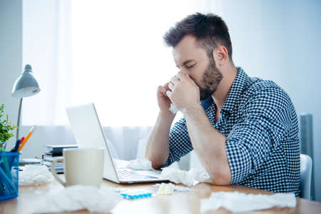 running nose: Portrait of ill businessman with fever and running nose