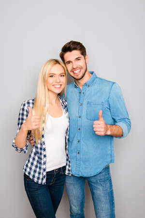 Happy smiling man and woman huging and gesturing