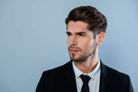 harsh: Portrait of handsome harsh man with bristle in black suit Stock Photo