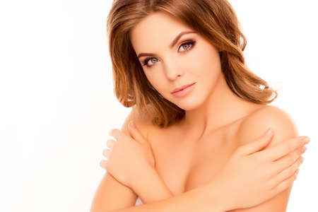 Portrait of beautiful young woman touching skin on shoulders Stock Photo