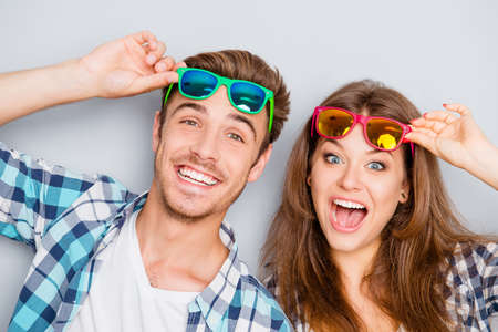 funny glasses: Portrait of cheerful laughing funny young  lovers in glasses Stock Photo