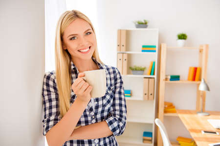 Young happy woman  having break and drinking coffee Stock Photo - 61770409