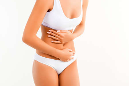 constipation symptom: Close up of woman having abdominal pain or menstrual cramps