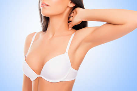 Close up portrait of shapely young woman in white bra Stock Photo - 61771900
