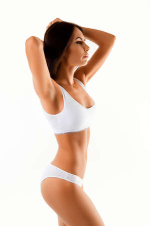 Side view of young woman in white underwear with perfect figure Stock Photo