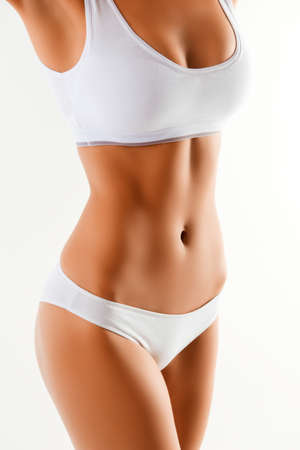 Close up portrait of healthy fit slim womans body