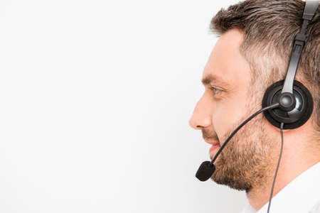 caller: Side view of smiling operator of call center in headphones