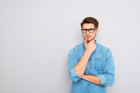 minded: Portrait of handsome minded young man in glasses think Stock Photo