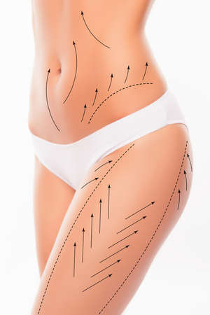 Close up photo of slim woman's body  with drawing arrows on it Reklamní fotografie - 61873932