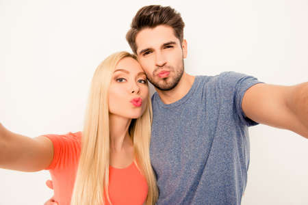 pouting: Young happy couple in love pouting and making selfie