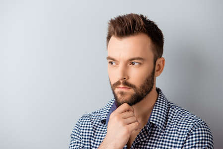 ponder: Handsome ponder bearded guy dreaming about future job