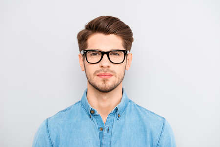 minded: Portrait of serious calm minded businessman wearing glasses