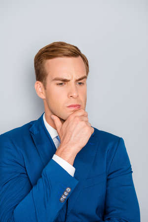 ponder: Portrait of young ponder businessman touching his chin Stock Photo