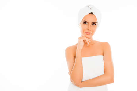 minded: Attractive minded woman in towel after shower on white background Stock Photo