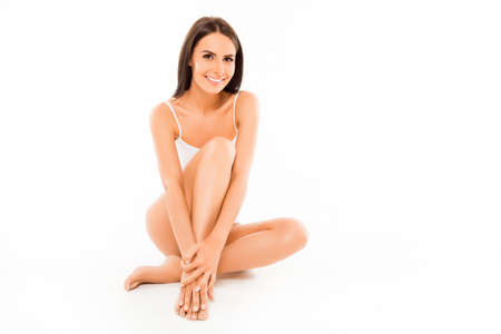 Pretty happy sexy woman demonstrating her legs with smooth skin Stock Photo