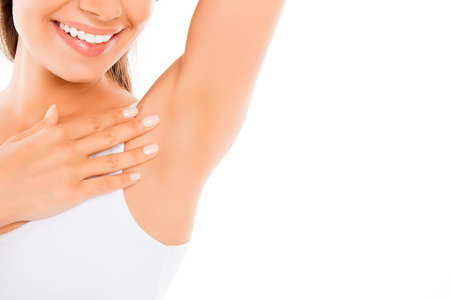 depilation: Close up of  happy young woman showing her smooth armpit