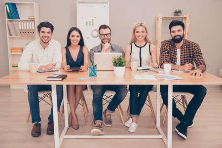 comit� d entreprise: photo of  happy young  group of   businesspeople sitting at conference table smiling